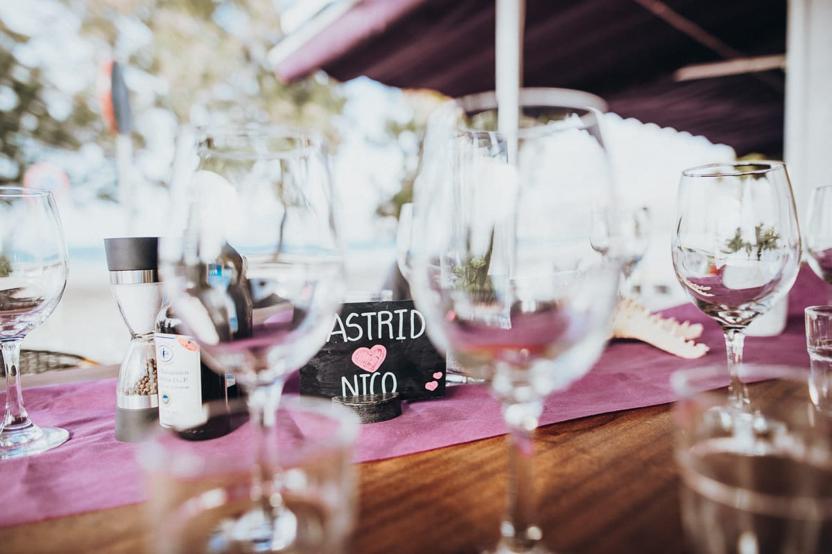 Close-up photo of the table where the bride and groom's name is written on a chalkboard.