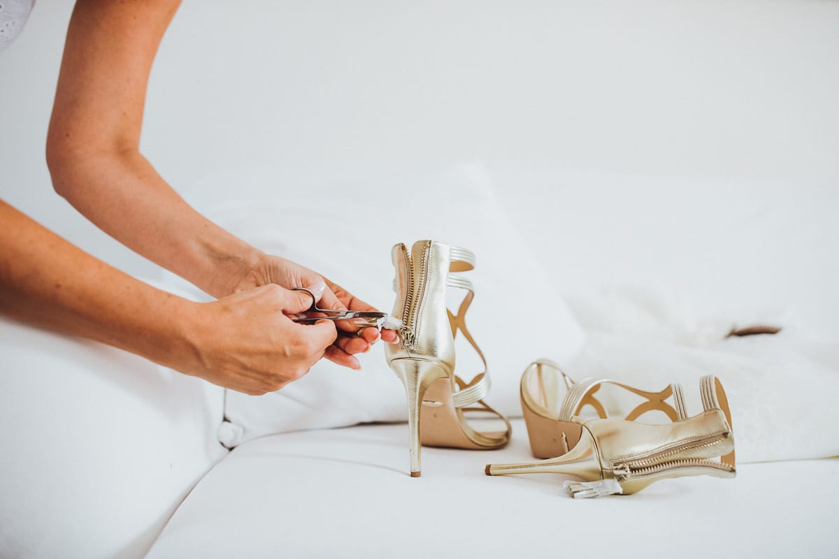 The bride is preparing her wedding shoes.