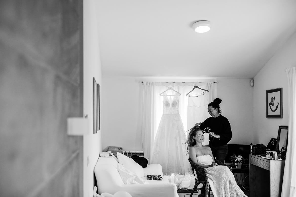Hair drying of the bride in her room.