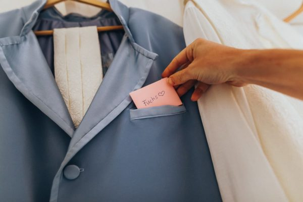 The groom has a small letter of his wife in his suit.