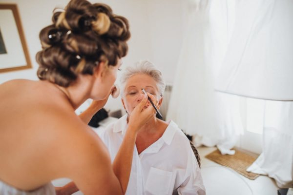 Close-up of how the bride makes up her mother.
