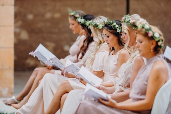 All bridesmaids sing a hymn in the church.