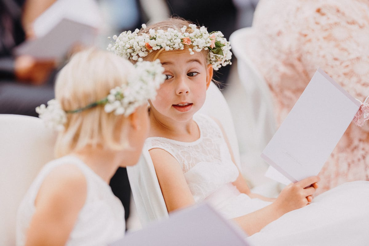 One of the little bridesmaids with important look on her little girlfriend.