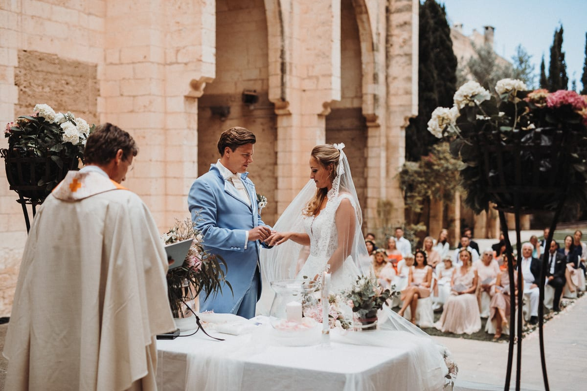 Ring exchange in the only roofless church, the Iglesia Nova in Majorca.
