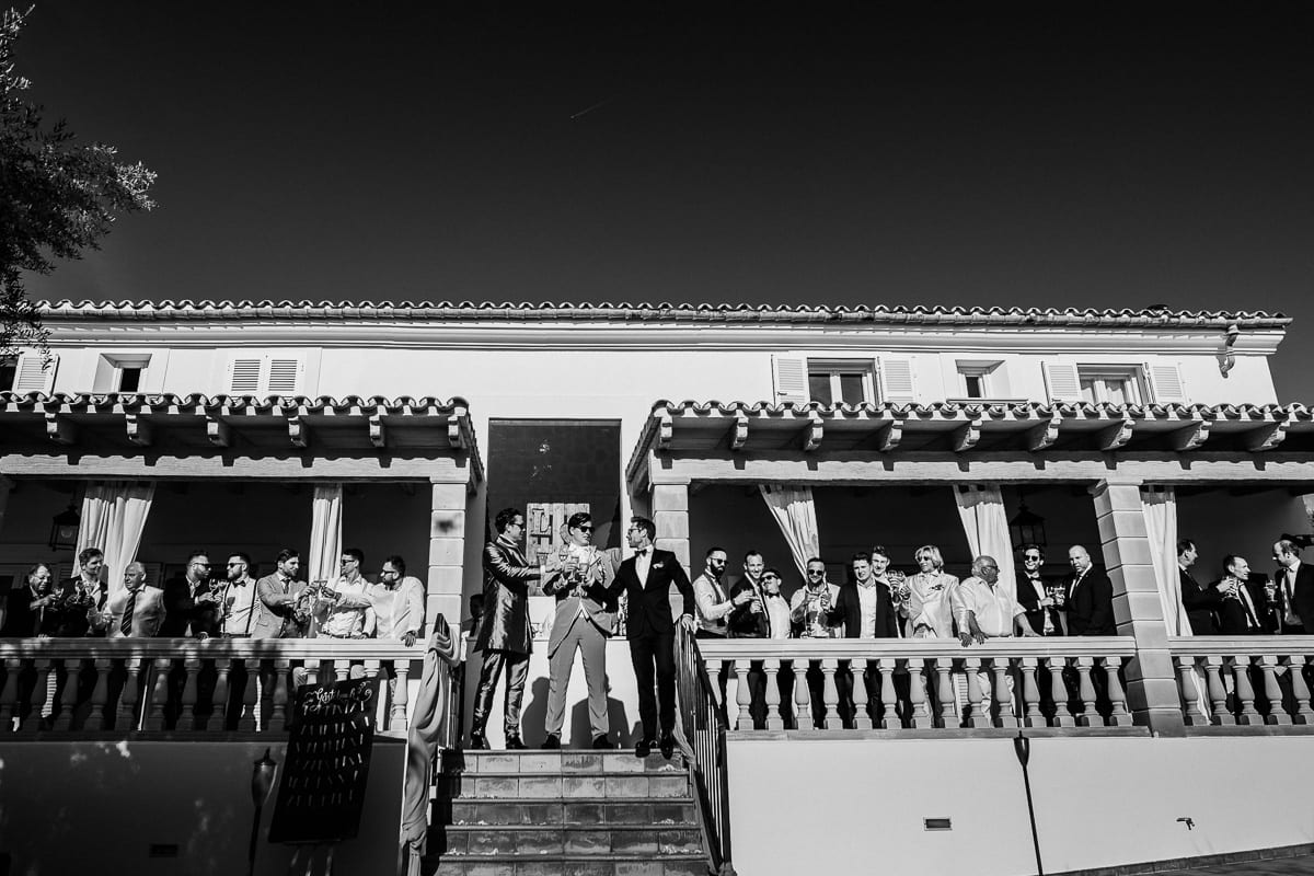 Men group photo on the porch of Finca Tortuga.