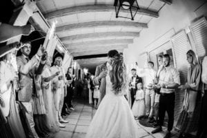 The first dance of the bridal couple in the evening surrounded by their guests with sparklers in their hands.