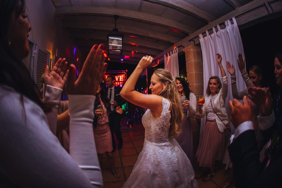 The bride is dancing at her wedding party.