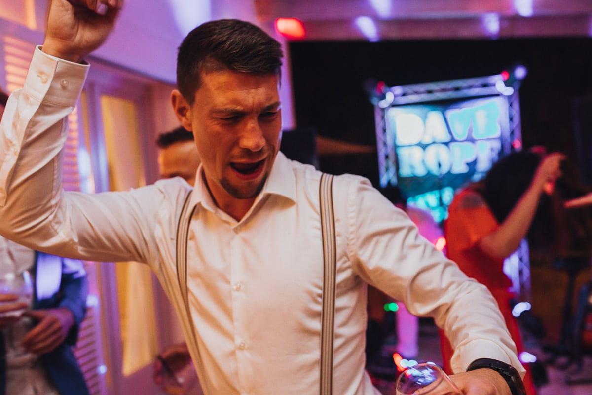 The groom's friend rocks the dance floor.