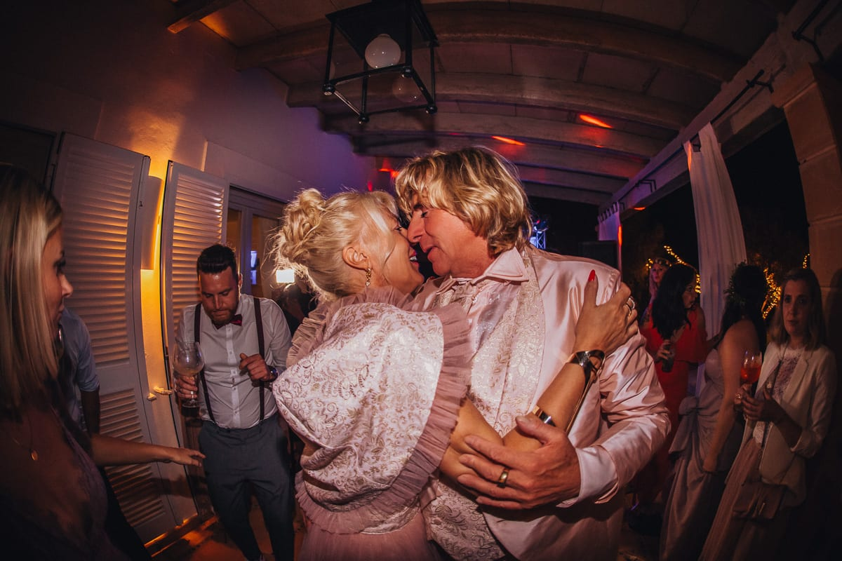 The parents of the groom dancing totally in love in the middle of the dance floor of the wedding party.