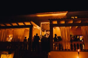 The wedding party terrace by night with the silhouettes of the guests.