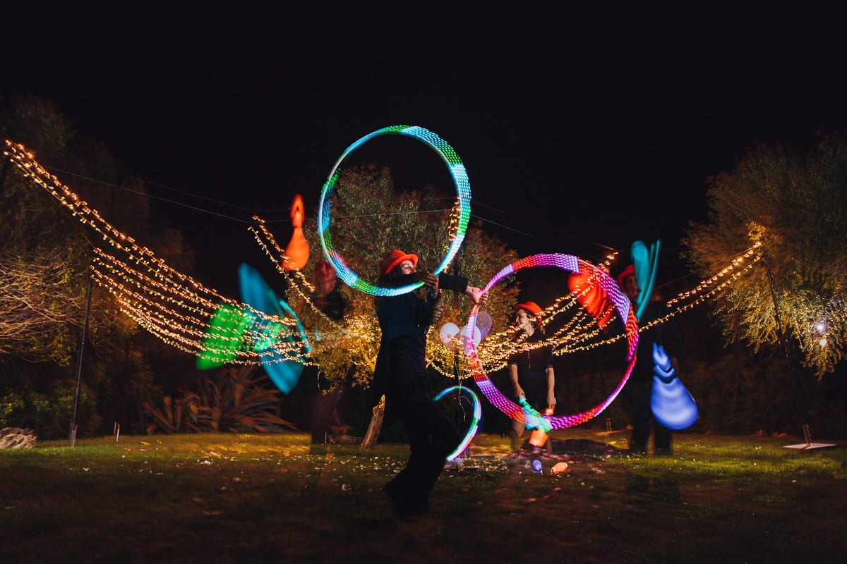 Double exposure of the light artists at night as a light program.