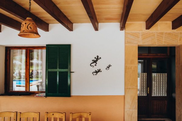 Detail of the entrance of the Finca Can Toni with the breakfast guests reflecting in the window.