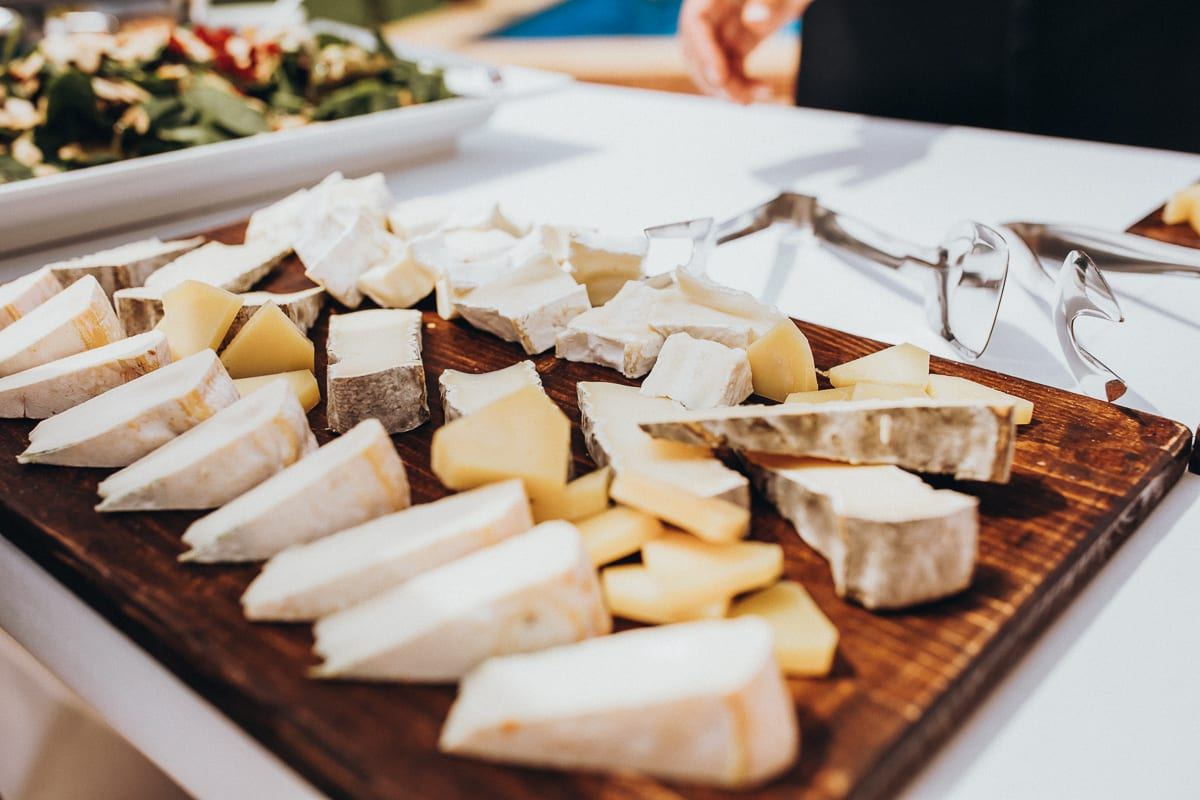 Delicious Mallorcan cheese plate of the Wedding - Catering Fosh setting up the brunch buffett.