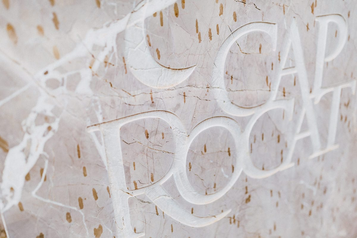 The letters of the name Cap Rocat on a stone what is on the entrance.