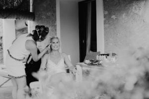 The bride smiling during she is made up.