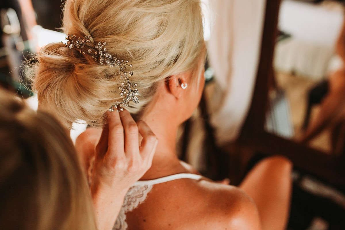 Putting the hair jewels on.