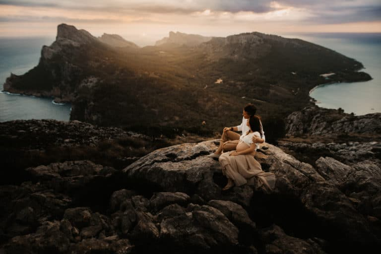 Pregnant couple in front of the beautiful countryside of Formentor.