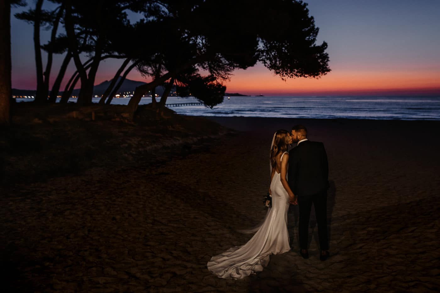 Bridal couple on the beach in Mallorca with the sunrise